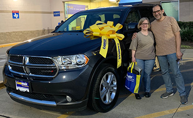Couple Stands Next To New Truck Purchase