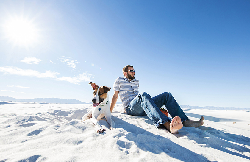 man with dog at white sands national park