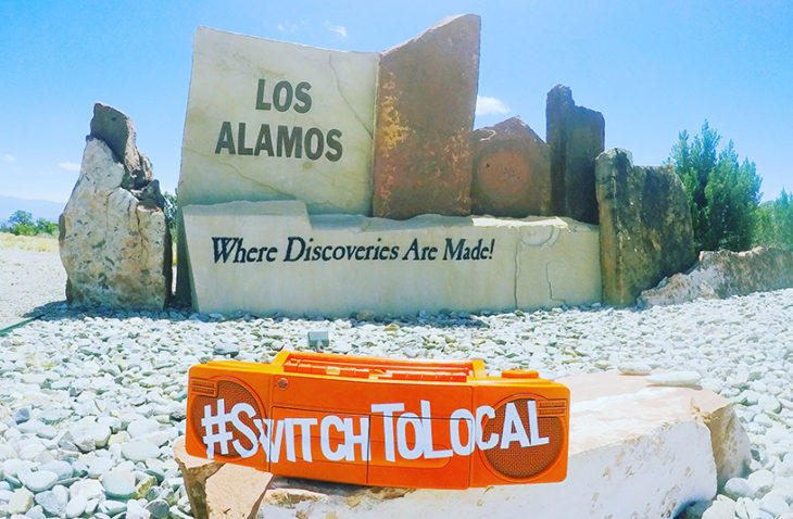 los alamos welcom sign with Switch to local stereo