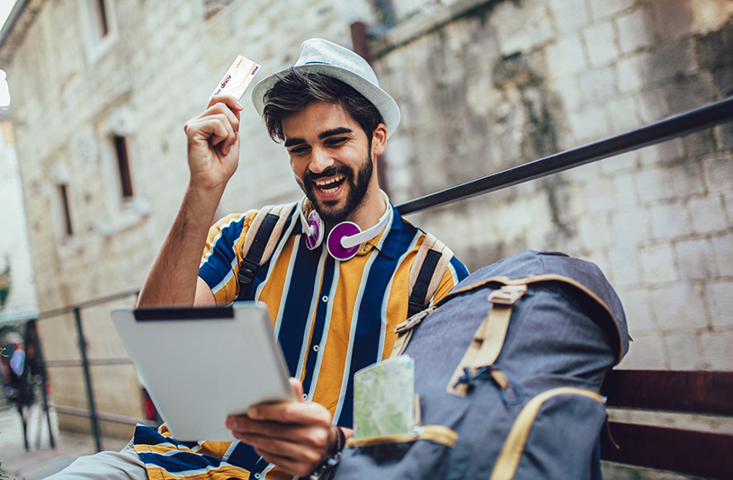 Hispanic Man Traveling with credit card