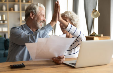 Older couple Making online payments with online banking