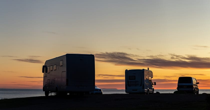 RVs parked at sunset