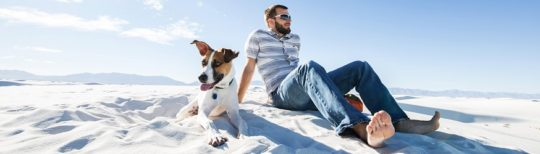 Man and dog visit White Sands, New Mexico