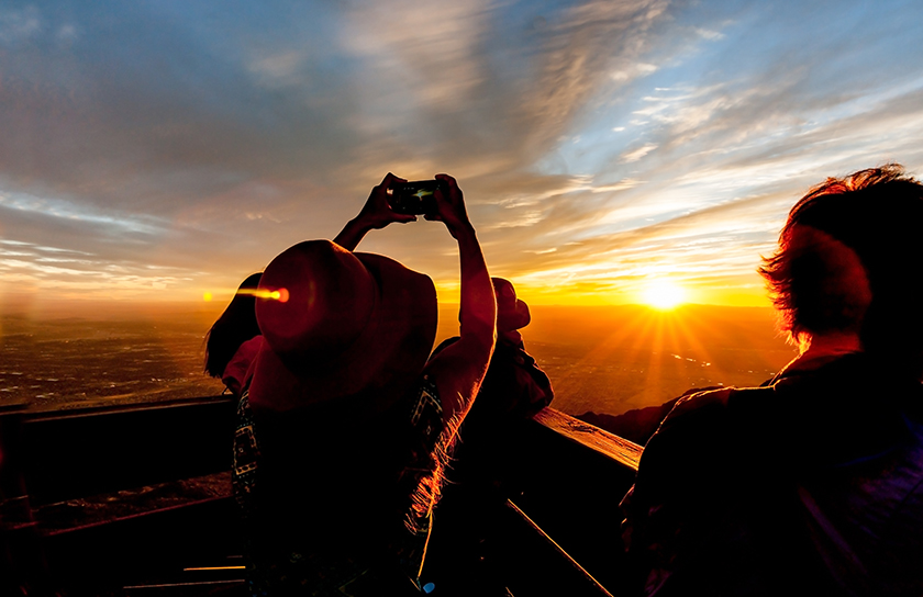 friend looking and taking pictures of the sunset