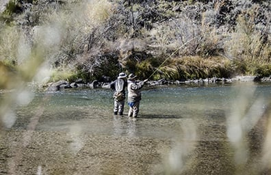 friends fly fishing in the rio grande by taos new mexico