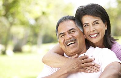 hispanic couple hugging and smiling