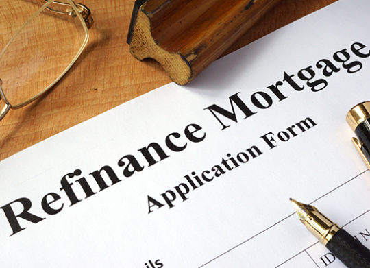 mortgage refinance calculator with paper pen