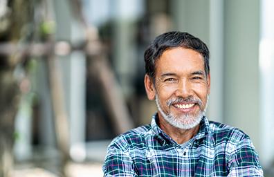 older-hispanic-man looking and smiling at the camera
