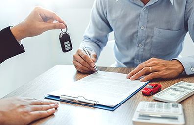 signing for car and getting keys