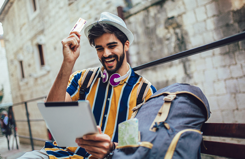 young man traveling using dncu credit card