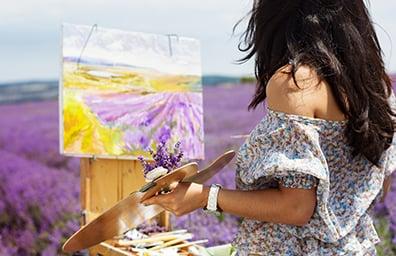 woman paints lavender fields